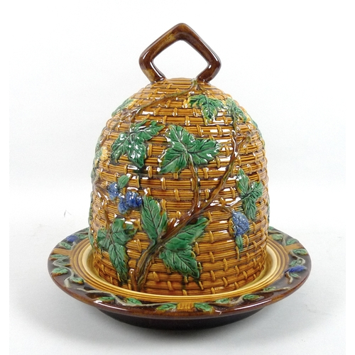 8 - A 20th century ceramic majolica cheese cover and stand, in the form of a beehive with moulded basket...