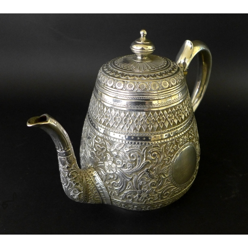 91 - A late Victorian silver four piece tea service for the Indian market, repousse decorated in Mughal s...