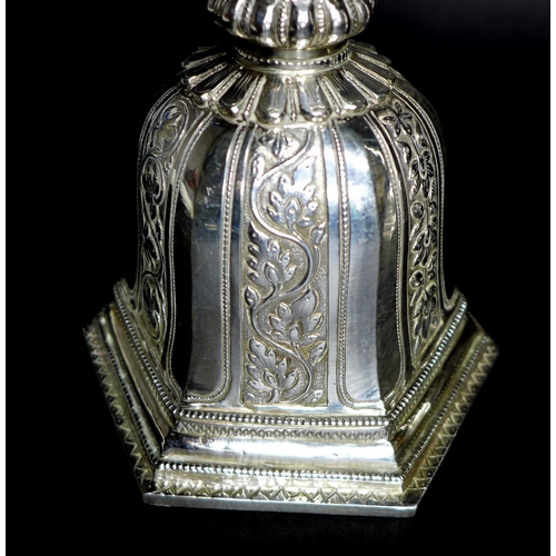 90 - A pair of early 20th century Southern Indian silver candlesticks, the wide drip trays engraved with ...