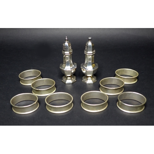 15 - A silver salt and a silver pepper pot, each 10.2cm high, Birmingham 1991,  together with eight napki...