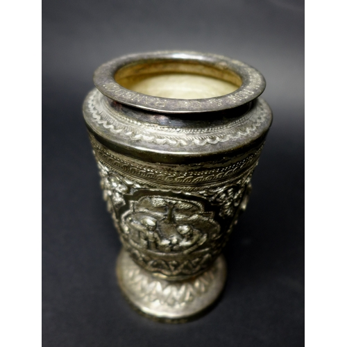 32 - A group of silver and plated items comprising a Burmese silver beaker with chased and repousse panel...