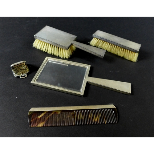 20 - A group of Art Deco silver dressing table items for a gentleman, comprising a Swiss movement silver ...