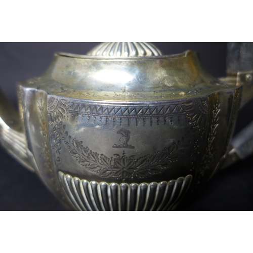 35 - A Victorian silver three piece tea set, with bright cut decoration and reeded bases, comprising teap...