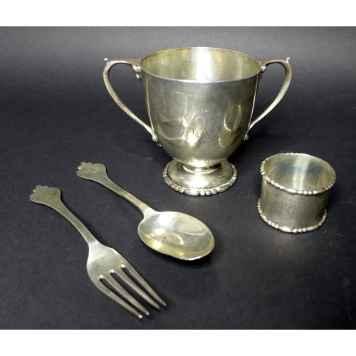 30 - A silver Christening set, Wakely & Wheeler London 1909-10 with twin handled cup, 11.8 wide (includin...