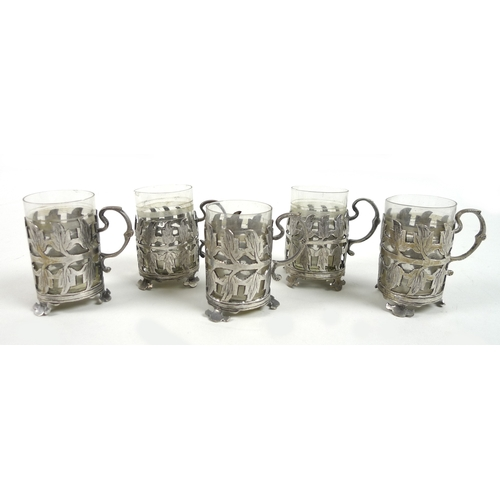 22 - A set of five early 20th century silver mounted glass Turkish tea cups, the mounts with a pierced le...