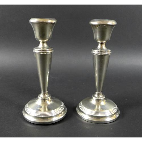 24 - An Edwardian silver spill vase, with pierced rim decoration, raised upon a hexagonal base, Walker & ...