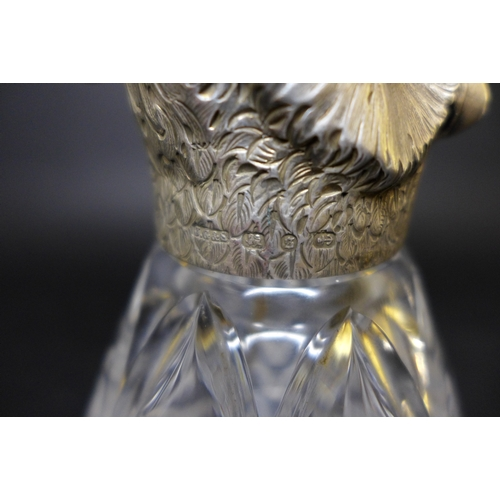 41 - A Victorian silver novelty atomiser, modelled as an owl with chased silver head and cut glass conica...