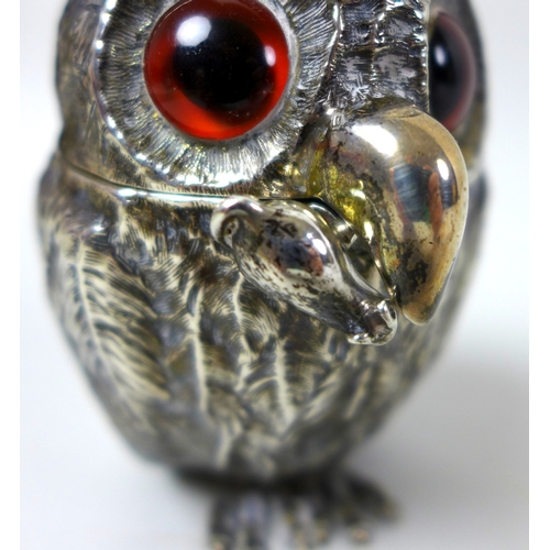 100 - An early Victorian silver novelty mustard pot, modelled as a standing owl, inset with glass eyes, th...