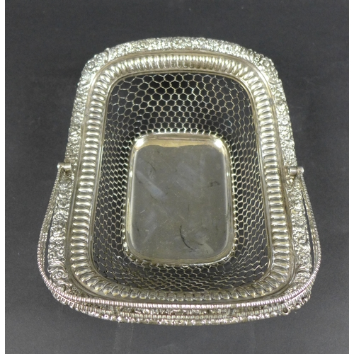 99 - A George III silver cake basket, of rectangular form with open wirework body, applied floral relief ...
