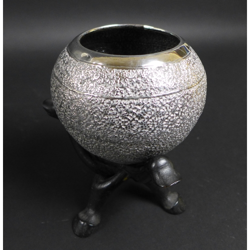47 - A pair of early 20th century Indian white metal spherical bowls with profuse foliate engraving, on c...