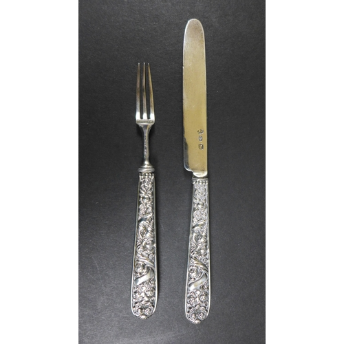 7 - A Georgian small silver butter and pickle fork, with filled foliate handles, both inscribed 'JP 1825...