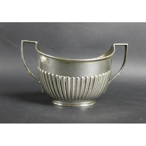 98 - An Edwardian silver four piece tea and coffee service, of pedestal form with half reeded bodies, com...
