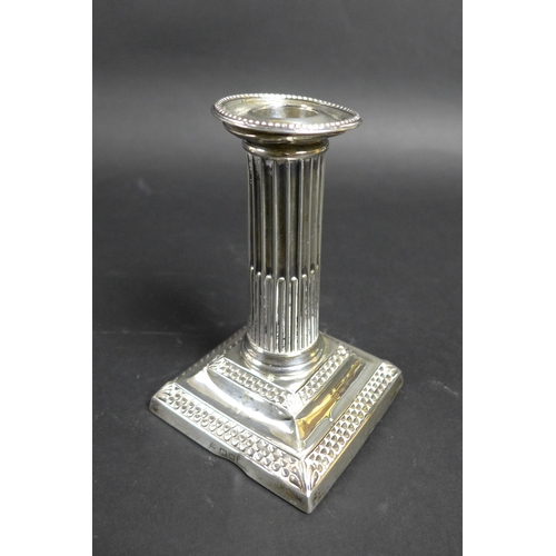 52 - A pair of late Victorian silver dwarf candlesticks, of Roman Doric column form, with square plinths,...