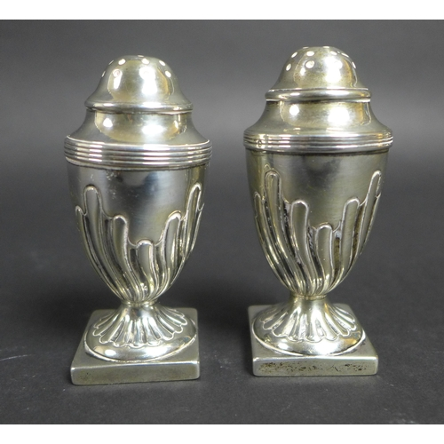 51 - A group of nine silver items, comprising a pair of octagonal form pepper pots, James Deakin & Sons, ...