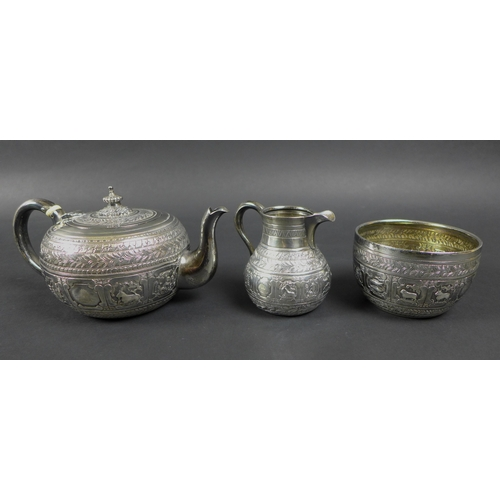 89 - A Victorian silver three piece tea service, decorated after Indian Mughal style and embossed with ni...