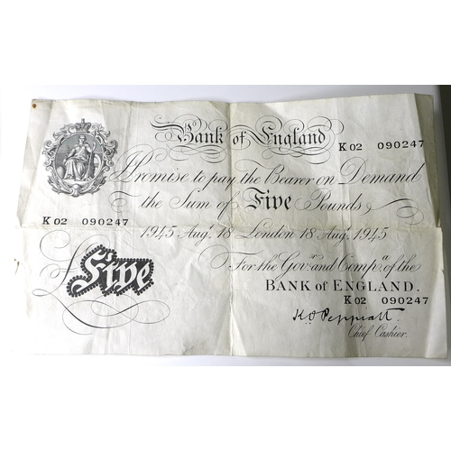 102 - A Bank of England 'Peppiatt' white £5 note, serial K02 090247, dated London 18th August 1945.