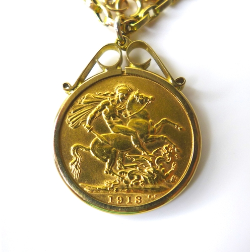 112 - A George V gold sovereign, 1913, in a 9ct gold mount and 9ct gold chain necklace, 50cm long, 16.2g t...
