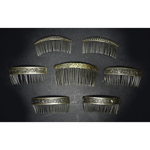 119 - A group of five 19th century Chinese white metal hair clips, comprising a quartet stamped with a sin...