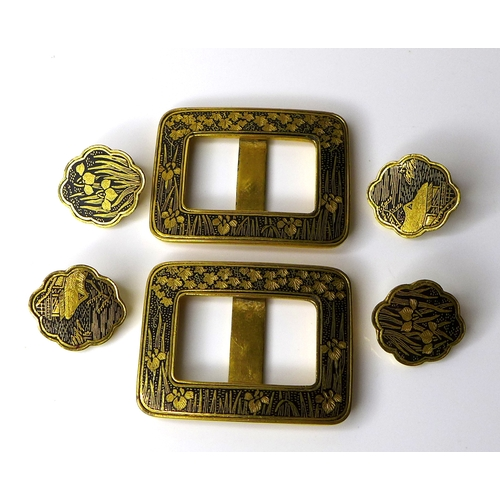 118 - A pair of Japanese niello buckles, circa 1930, together with two pairs of matching buttons, designed...