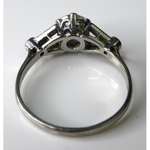338 - An Art Deco diamond and platinum ring, the central brilliant cut diamond of approximately 1.4ct, fla...