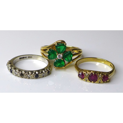 178 - Three 9ct gold rings, comprising an early 20th century three stone ruby ring, size M, a white gold, ...