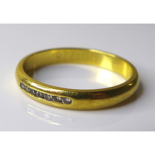 177 - An 18ct gold and diamond ring, set with seven small brilliant cut stones, size N, 2.9g....