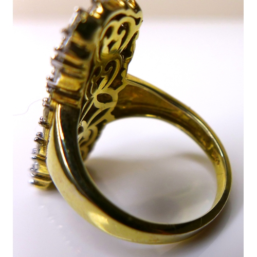174 - A diamond cluster ring inlaid with small baguette cut stones on an 18ct gold plated silver band, siz...