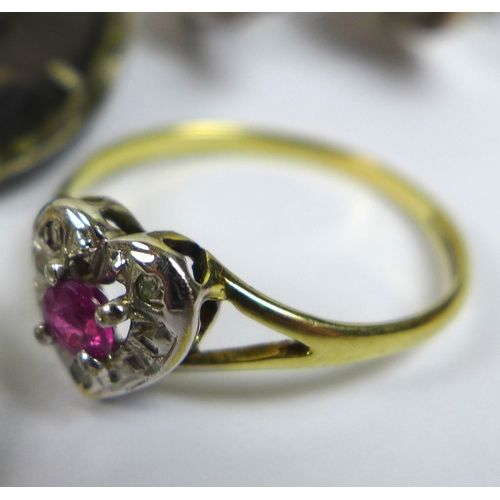 170 - An 18ct gold, platinum and diamond ring, with central platinum heart shaped setting, set with a smal...