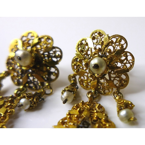 172 - A pair of 1930s Indian 9ct gold earrings with seed pearl drops, very fine pierced decoration, each e...