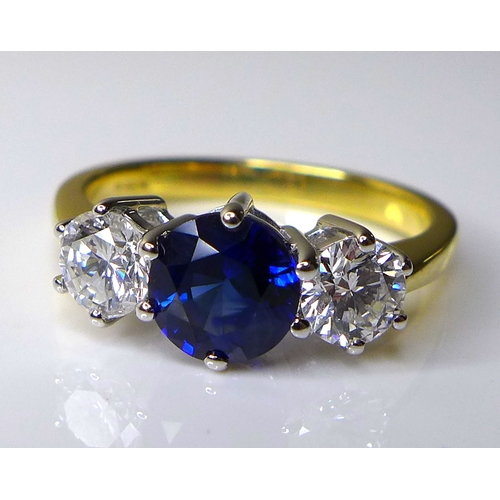 337 - An 18ct gold, diamond and sapphire three stone ring,  with central sapphire of approximately 1.2ct, ...