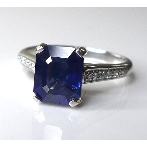 328 - A platinum, sapphire and diamond ring, the emerald cut deep cornflower blue sapphire of approximatel...