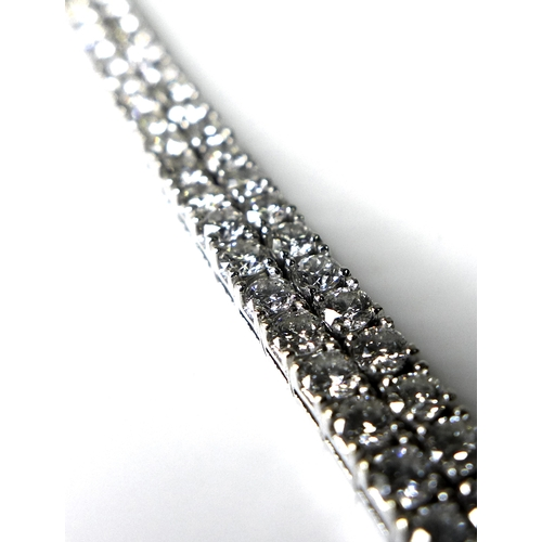 342 - An 18ct white gold double row diamond tennis bracelet, comprising one hundred and forty four brillia...