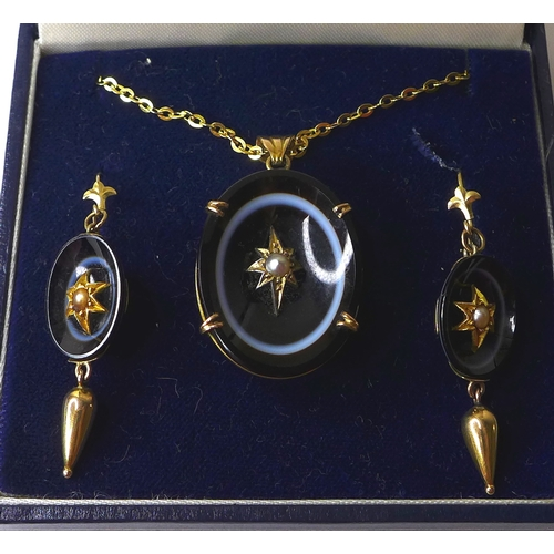 188 - A 19th century French mourning pendant of black bull's eye agate set with a central seed pearl in a ...