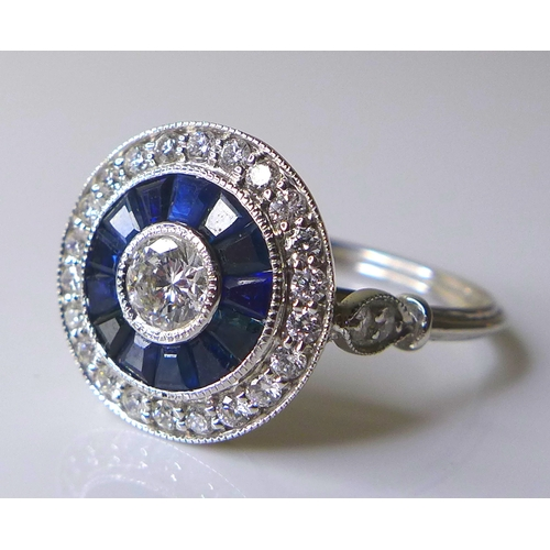 333 - An 18ct white gold, diamond and sapphire ring, of Art Deco style circular design, the central brilli...