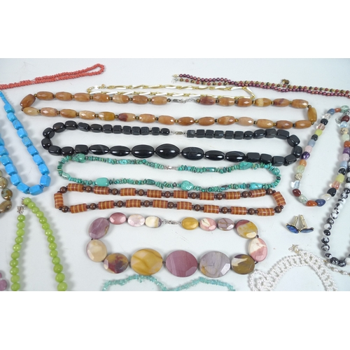 156 - A large quantity of costume jewellery, including an array of brightly coloured beaded necklaces and ...