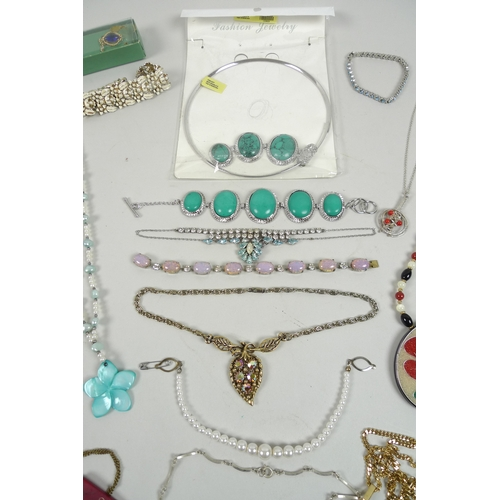 157 - A collection of costume jewellery, including a five stone turquoise T bar bracelet, with matching ch...