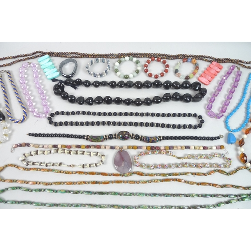 166 - A large quantity of costume jewellery, including various coloured beaded necklaces and bracelets, an...