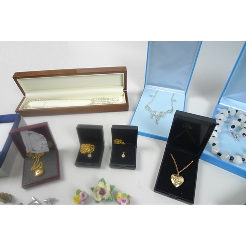 167 - A collection of costume jewellery, including a group of boxed necklaces, a group of yellow and white...