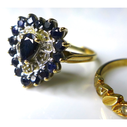 183 - A 9ct gold sapphire cluster ring, the pear cut central sapphire 6mm long, surrounded by five illusio...