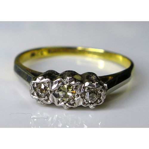 164 - An 18ct gold and platinum three stone diamond ring, illusion set, central stone 0.1ct, size N, 2.3g....