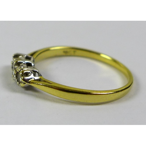 187 - An 18ct gold three stone diamond ring, size O/P, central stone of approximately 0.13ct, 3.35mm diame...