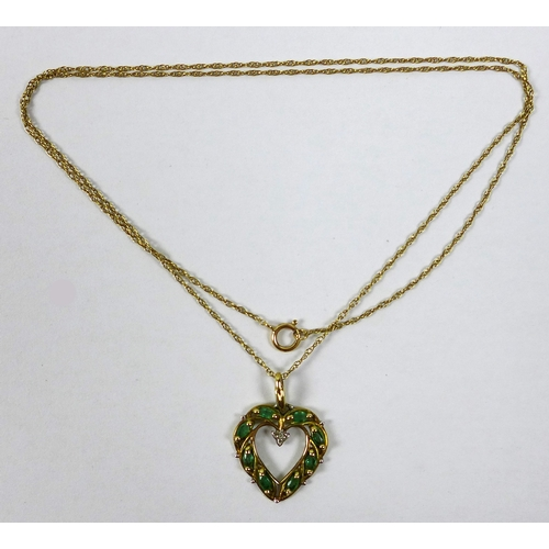 184 - A 9ct gold, emerald and diamond heart shaped pendant, 2cm long, on a 9ct gold chain, 51cm long, 2.8g...