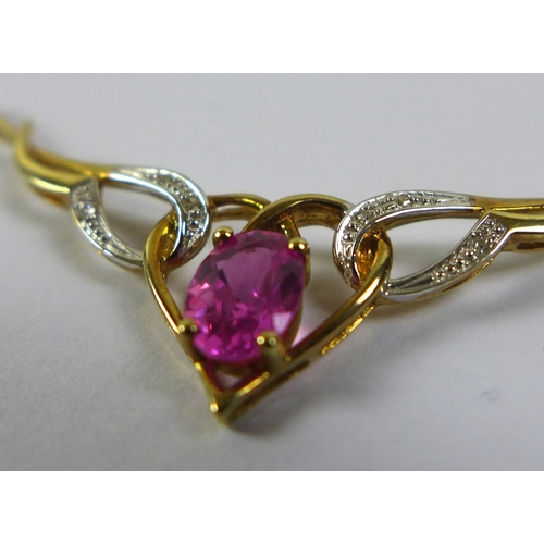 185 - A 9ct gold ruby and illusion set diamond necklace, the pendant of winged heart design, 5.3cm wide, o...
