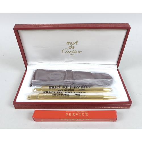 116 - A Must de Cartier ballpoint pen and pencil set, composed of Stylo Mine Must II and Must II Propellin...