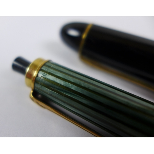 115 - A vintage Pelikan 140 green and black fountain pen, with 14ct gold nib, 12.5cm, together with matchi...