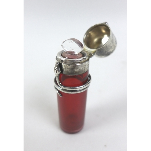 124 - An Arts & Crafts silver mounted scent bottle, influenced by the designs of Archibald Knox and Charle...
