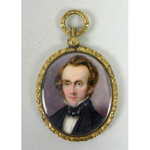 123 - A Victorian oval portrait miniature, half length, depicting a Victorian gentleman with blue cravat, ...