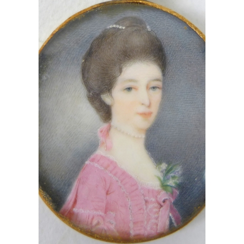 122 - A Georgian gold cased pendant oval portrait miniature, half length, depicting a Georgian lady with b...