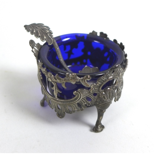 59 - A William IV / early Victorian silver set of four salt cellars, of circular pierced floral swag desi...