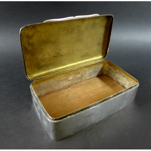 31 - A group of silver items, comprising a silver cigarette case, with engraved initials E.F.M. upon its ...